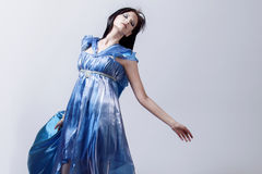 Fashion photo of young magnificent woman in blue Royalty Free Stock Photography