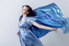 Fashion photo of young magnificent woman in blue Royalty Free Stock Images