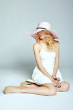 Fashion photo of young magnificent woman in hat. Girl posing Stock Image