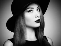 Fashion photo of young magnificent woman in hat. Girl posing Stock Photos