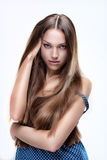 Fashion photo of young magnificent woman with long hair Stock Photo