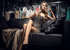 Fashion photo of young magnificent woman in luxury dress. Stock Photos