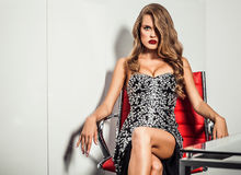 Fashion photo of young magnificent woman in luxury dress. Royalty Free Stock Images