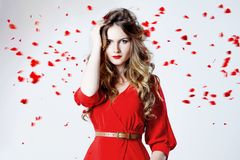 Fashion photo of young magnificent woman in red Royalty Free Stock Images