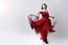 Fashion photo of young magnificent woman in red Stock Photos