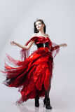 Fashion photo of young magnificent woman in red Stock Image