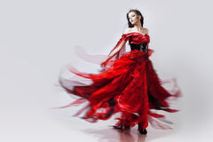 Fashion photo of young magnificent woman in red Stock Photo
