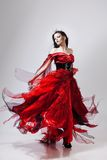 Fashion photo of young magnificent woman in red Stock Photography