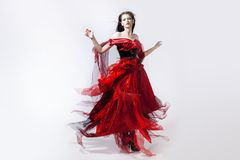 Fashion photo of young magnificent woman in red Royalty Free Stock Photo