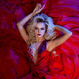 Fashion photo of young magnificent woman in red dress. Studio portrait stock images