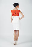 Fashion photo of young magnificent woman in a white and orange d Stock Photography