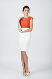 Fashion photo of young magnificent woman in a white and orange d Royalty Free Stock Photo