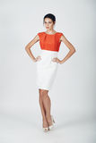Fashion photo of young magnificent woman in a white and orange d Royalty Free Stock Image