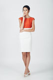 Fashion photo of young magnificent woman in a white and orange d Royalty Free Stock Photography