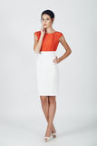 Fashion photo of young magnificent woman in a white and orange d Stock Image