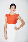 Fashion photo of young magnificent woman in a white and orange d Stock Photos