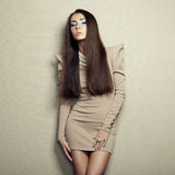 Fashion photo of young sensual woman in beige dress Stock Photos