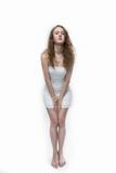 Fashion  photo of a young woman with curly hair wearing white dress Royalty Free Stock Image