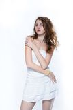 Fashion  photo of a young woman with curly hair wearing white dress Royalty Free Stock Photo
