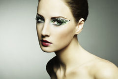 Fashion photo of a young woman with long eyelashes Stock Photos