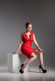 Fashion photo of young woman in red dress Stock Images