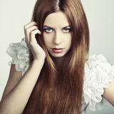 Fashion photo of a young woman with red hair Stock Images