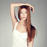 Fashion photo of a young woman with red hair Royalty Free Stock Photos