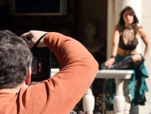 Fashion Photographer. In action (low Depth of field) photographer in Focus stock photography