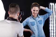 Fashion photographer during work. With beautiful model Stock Images