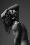 Fashion photography nude body young man model wet long hair. Studio Stock Photography