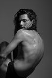 Fashion photography nude body young man model wet long hair Royalty Free Stock Photo