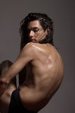 Fashion photography nude body young man model wet long hair Stock Photos