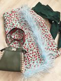 Fashion picture. Skirt, boots, handbag, feathers look of the day Royalty Free Stock Image