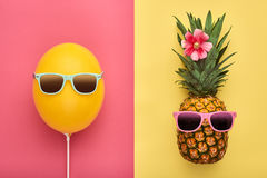 Fashion Pineapple. Air Balloon. Summer.Minimal Fun. Fashion Pineapple and Pink air Balloon. Bright Summer Color, Accessories. Tropical Hipster pineapple with Royalty Free Stock Image