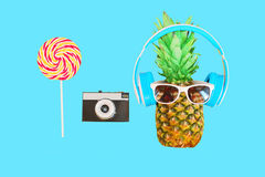 Fashion pineapple with sunglasses and headphones vintage camera Stock Photography