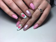 Fashion pink manicure on a textural background stock images