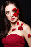 Fashion portrair of woman with rose petals on her face. Fashion portrair of woman with rose petals Stock Images