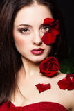 Fashion portrair of woman with rose petals on her face Stock Photos