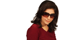 Fashion portrait. Of a beautiful young woman wearing sunglasses royalty free stock images
