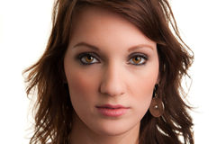 Fashion Portrait. Attractive brunette stares into camera for a fashion portrait; flawless skin with makeup stock photo