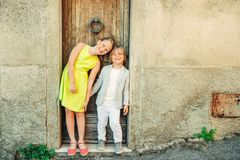 Fashion portrait of adorable little boy and girl stock photos