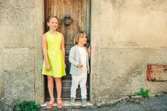 Fashion portrait of adorable little boy and girl royalty free stock photography