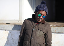 Fashion portrait african man wearing a sunglasses and jacket Royalty Free Stock Photography