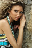 Fashion portrait against stone wall Stock Images