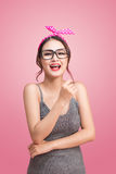 Fashion portrait of asian girl with sunglasses standing on pink Stock Images
