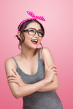 Fashion portrait of asian girl with sunglasses standing on pink Stock Photo