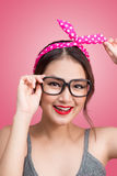 Fashion portrait of asian girl with sunglasses standing on pink Royalty Free Stock Photos