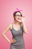 Fashion portrait of asian girl with sunglasses standing on pink. Background royalty free stock image