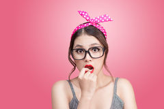 Fashion portrait of asian girl with sunglasses standing on pink stock photos
