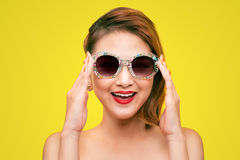 Fashion portrait of asian girl with sunglasses wearing pastel st royalty free stock photography